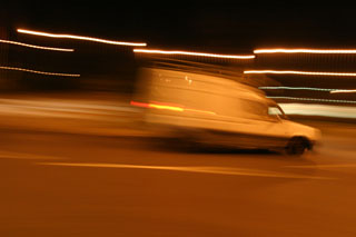 A car zooming through the roundabout
